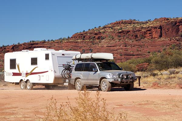 4WD-towing -a -caravan -in -australian -outback