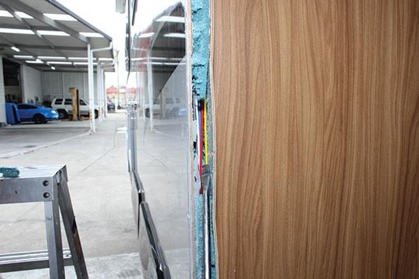 Caravan -door -insulation -being -removed -around -the -door -aperture -and -wiring -is -routed