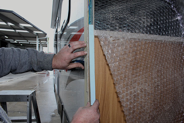 Timber -is -inserted -and -glued -into -place -for -the -caravan -door