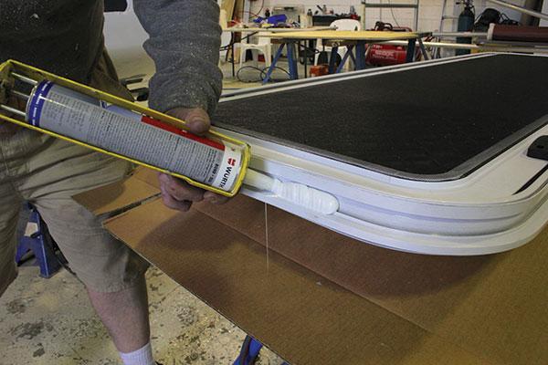 Polyurethane -is -applied -to -the -caravan -door -frame