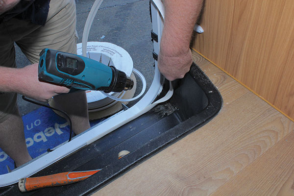 T-mould -is -fitted -to -the -inside -join -and -heated -on -the -corners -for -the -caravan -door