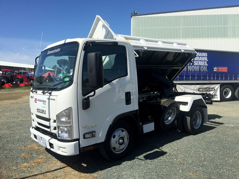 The Isuzu NLR Tri-Tipper side on