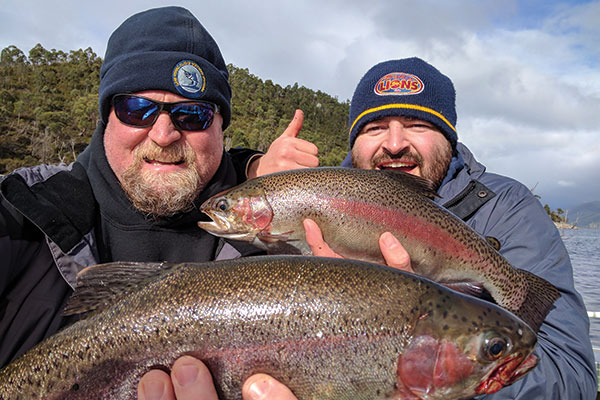 Two -men -holding -Tasmanian -trout