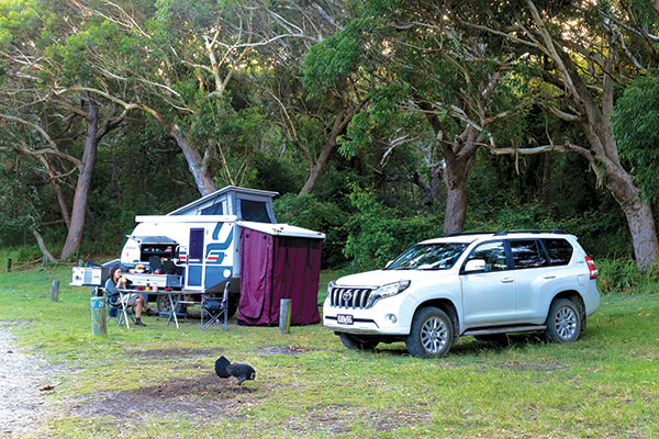 Caravan -setup -next -to -a -car -at -campsite -Yagoon