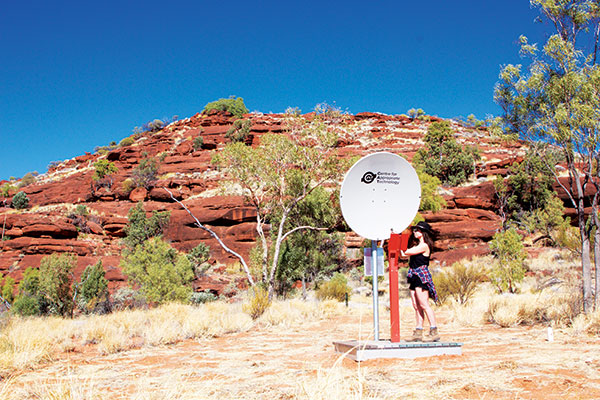 A-woman -next -to -the -satelite -dish -in -Finke -Gorge -NT