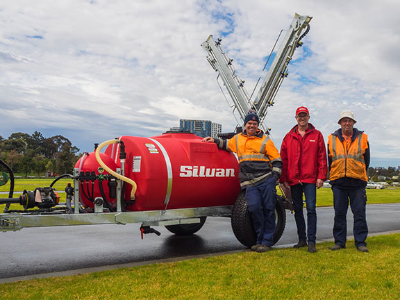 The Silvan sprayer with Victoria Racing club officials