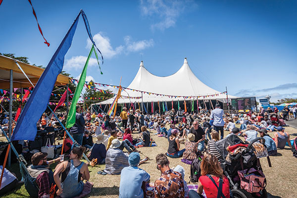 Queenscliff -Music -Festival -people -sitting -on -the -ground -next -to -the -stage