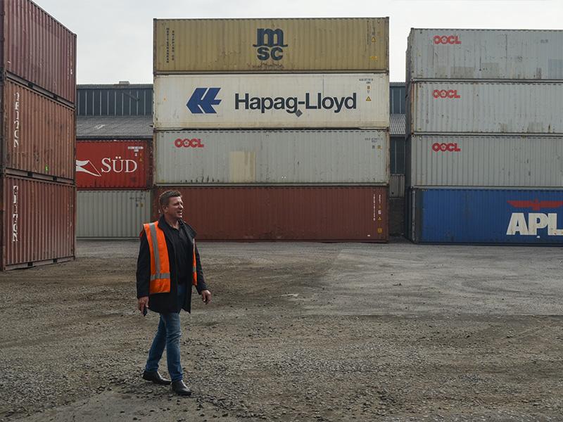 Scott Lovatt, man among the containers