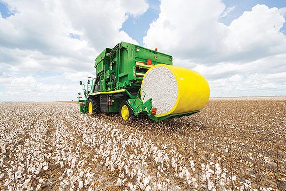 The John Deere CP690 cotton picker in a field