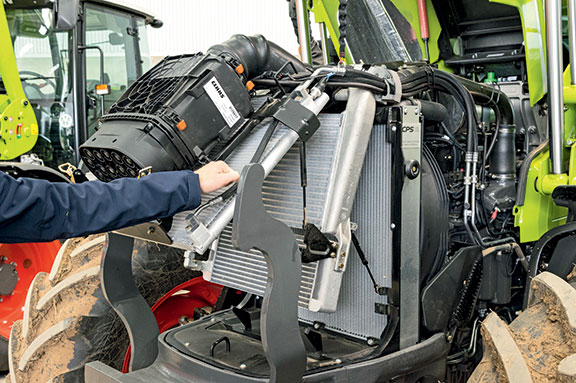 Under the Claas Arion 440 bonnet