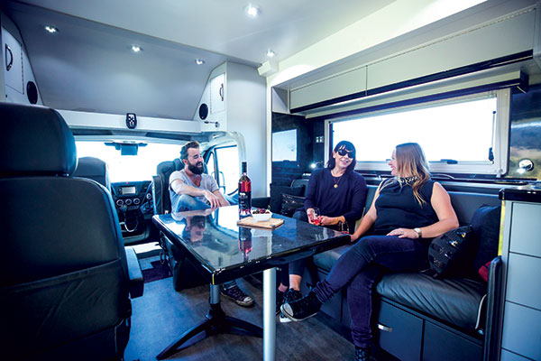 People -sitting -drinking -wine -in -Paradise -Independence -Deluxe -motorhome