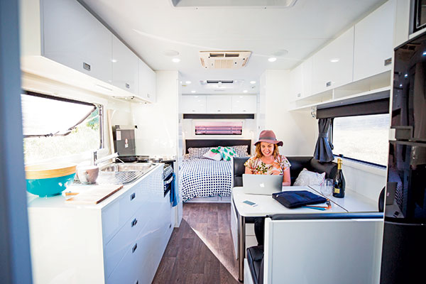 Woman -sitting -in -a -caravan -working -on -the -computer