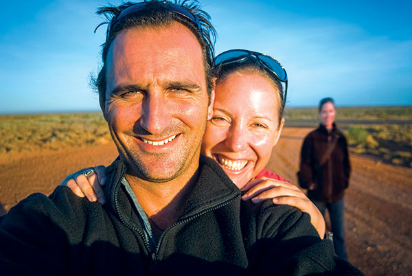 People -smiling -while -standing -on -the -road -in -Australian -outback