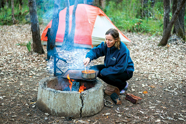 Woman -cooking -on -fire -at -the -campsite