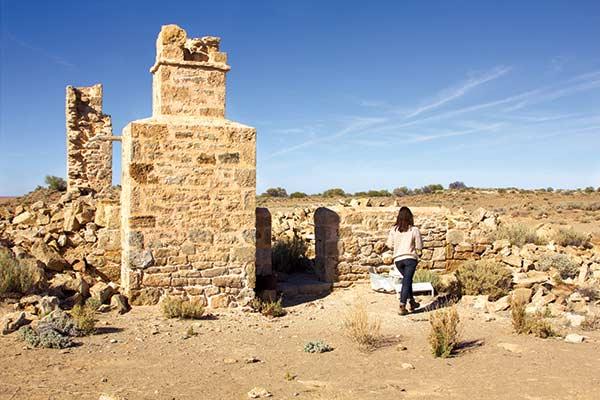 Woman -at -Strangways -Springs -ruins -walk