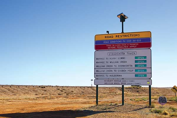 Oodnadatta -Track -road -sign -road -restrictions -due -to -heavy -rain