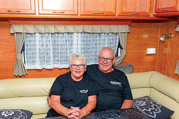 Couple -sitting -in -a -caravan -at -Option -RV-rally