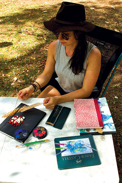 Woman -crafting -with -paints -and -pencils