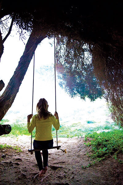 Woman -on -a -swing -at -Cliff -head