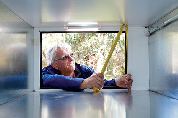 Man -measuring -storage -of -a -caravan -at -Best -Aussie -Vans -2017