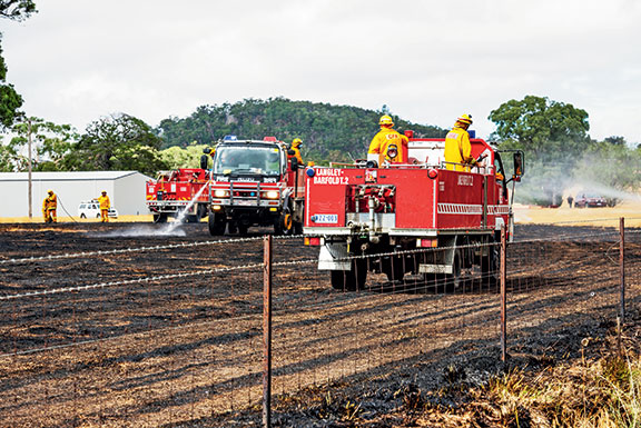 Victorian CFA members put out a grassfire in Langley