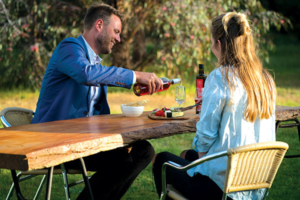 A-couple -having -wine -at -Red -Rocks -Olives -VIC