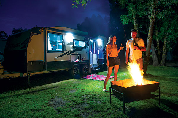 A-couple -having -drinks -by -the -fire -at -Halls -Gap -Caravan -Park -VIC