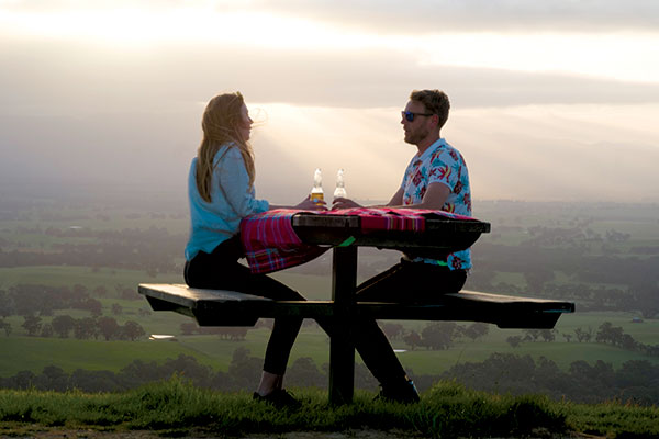 A-couple -having -beers -at -One -Tree -Hill -VIC