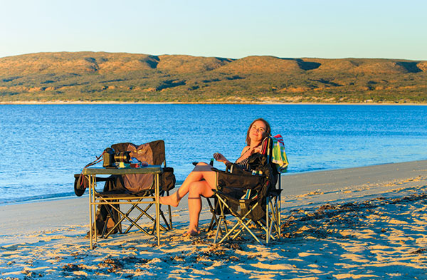 Woman -sitting -at -the -beach -in -a -camping -chair