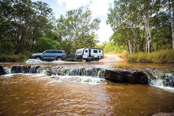 4WD-with -a -caravan -crossing -the -river -in -Cape -York -at -Race -to -the -Cape