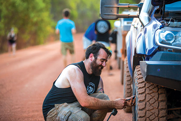 Man -working -on -tyres -in -Cape -York -at -Race -to -the -Cape