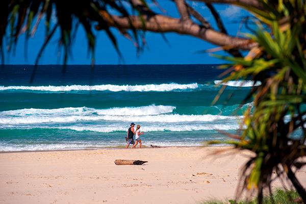 Couple -walking -on -the -Tweed -coast -beach