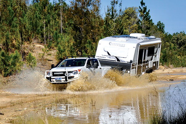 Sunseeker -caravan -towing -through -the -river -crossing