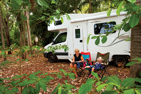 Camping -in -NT-people -sit -next -to -a -motorhome