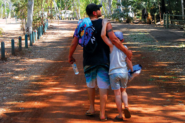 Family -walking -on -the -street -at -Mataranka -Homestead
