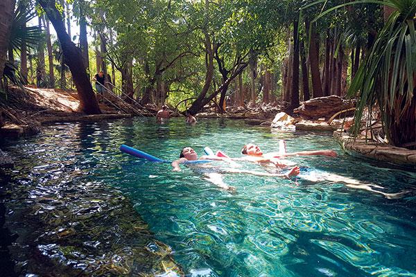 Family -swimming -in -waterholes -in -NT