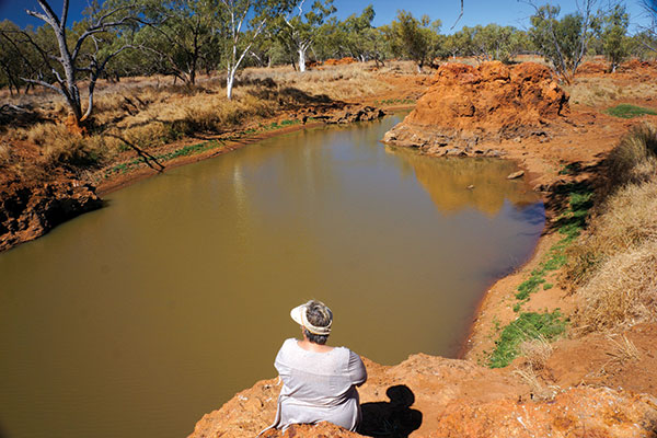 Woman -sitting -at -the -Police -Barracks -waterhole -on -the -Burke -River