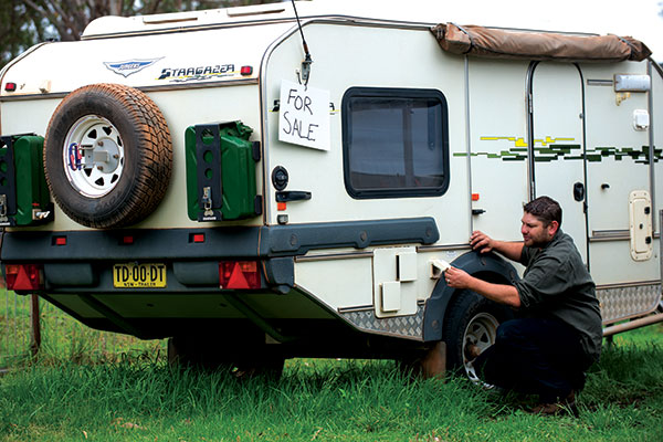 Inspecting -second -hand -camper -trailer