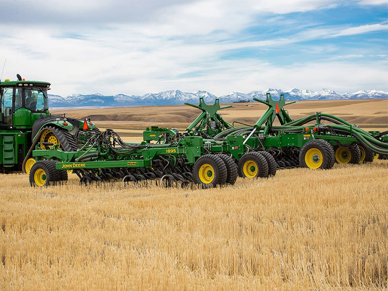 The John Deere 1895 aircart in a field of wheat