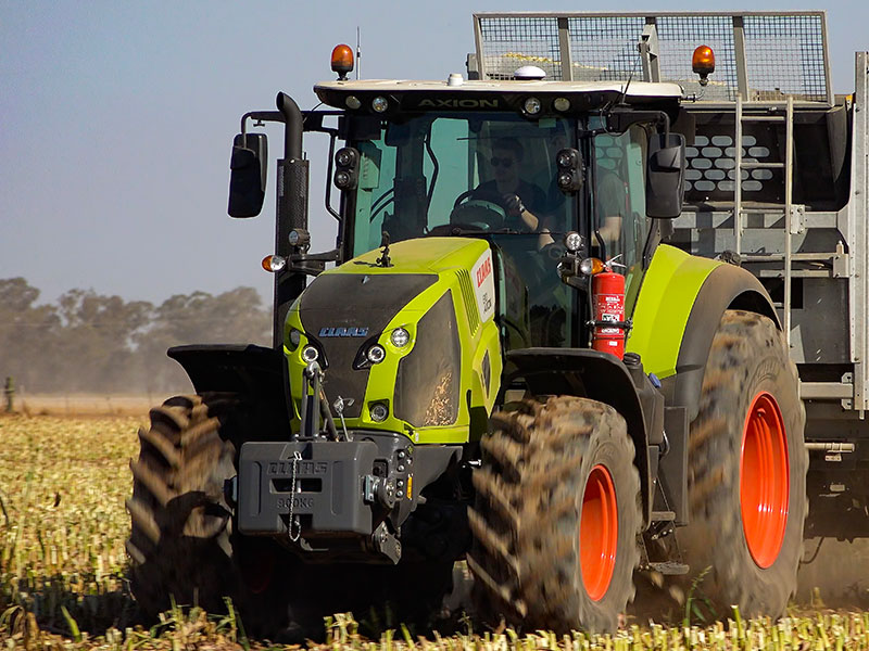 The Claas Axion 810 working in a maize field