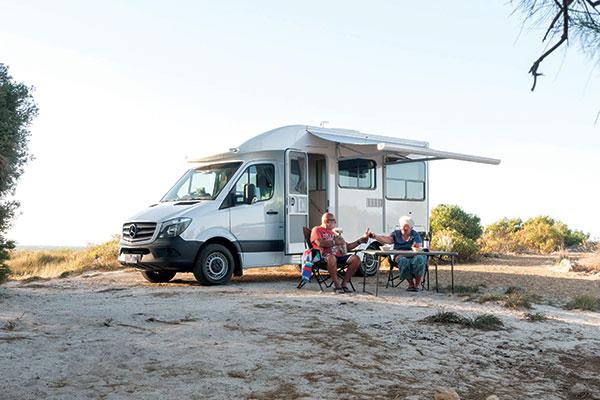 Grey -nomads -in -front -of -van