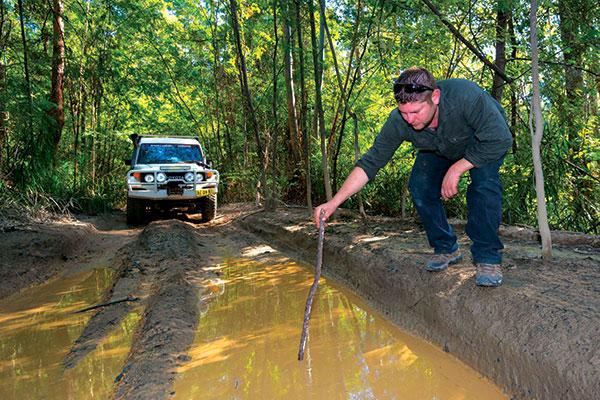 4WD-through -a -bog -hole -checking -the -depth