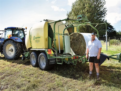 Wairarapa -dairy -farmer -Lewis -Herrick -with -the -Krone -Comprima -film -wrap -unit