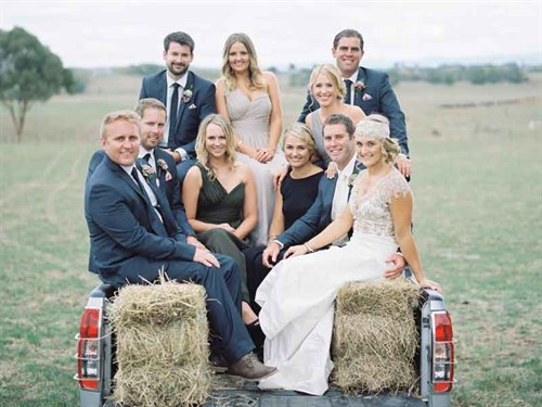 Mike -and -Ryley -at -right -with -their -wedding -party