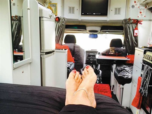 Dianna -puts -her -feet -up -in -her -cosy -motorhome