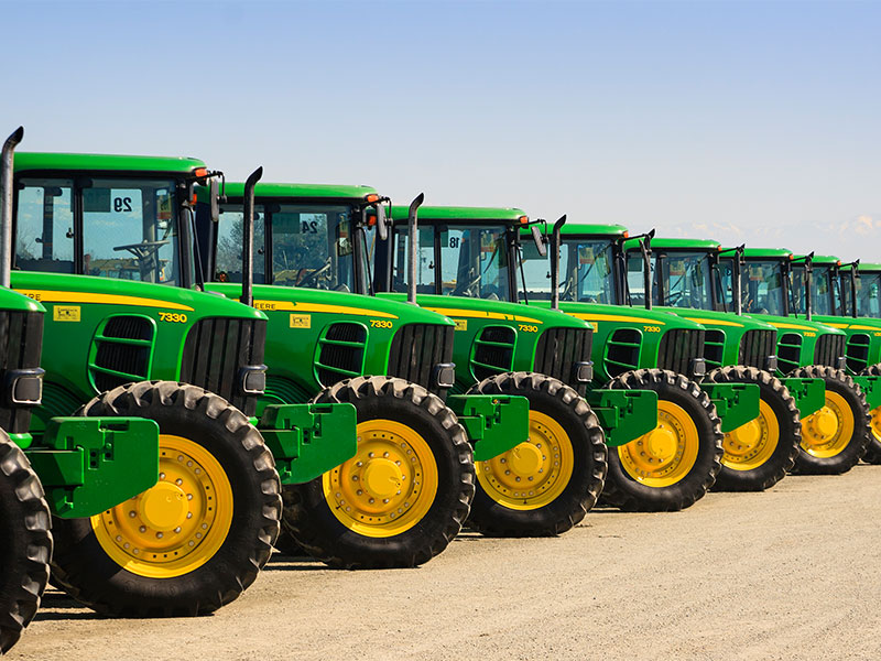 Tractors line up in a show for sale