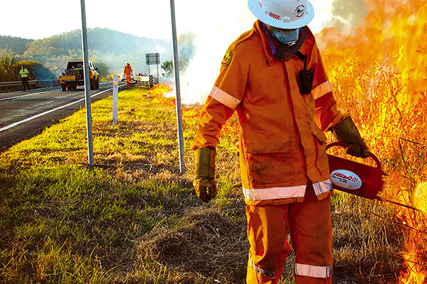 Firefighter -putting -out -a -fire -on -the -road