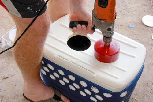 Drilling holes for the evaporative cooler's fans