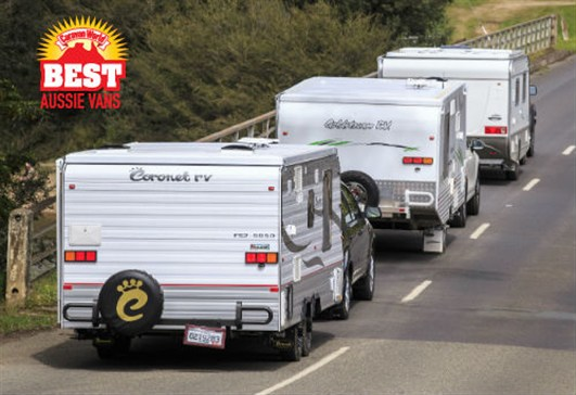 three Pop -top caravans on the road