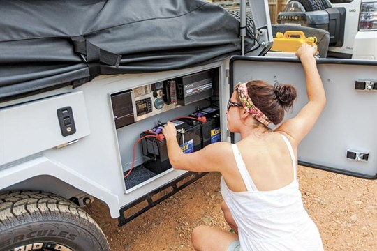 woman and camper trailer